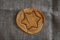 Brown sugar caramel candy cookies with a metal needle
