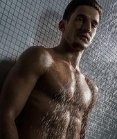 Muscular shirtless man shot in shower