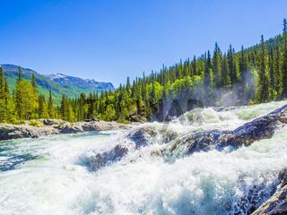 Fast flowing river water of beautiful waterfall Rjukandefossen Hemsedal Norway.