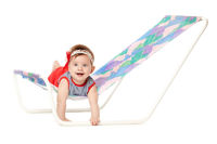 cute baby lying on lounger