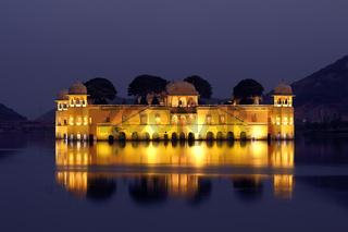 jal mahal palace on lake at night in India