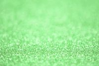 Texture of light green silver glitter dust surface, luxury background with bokeh