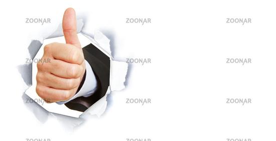 Manager zeigt Daumen hoch durch Loch in Papier
