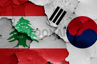 flags of Lebanon and South Korea painted on cracked wall