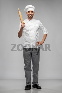 happy smiling male chef or baker with rolling pin