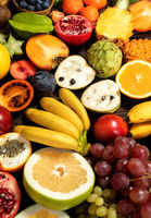 Table with fruit, tropical variety of mixed fruits on wooden background