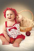 Little cute girl in red dress