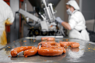Sausages production at the meat processing factory.