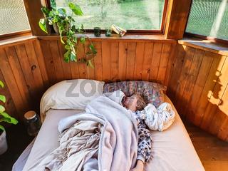 Young girl sleeping in full daylight