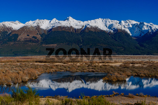 Reflection of snow mountains on lake in Glenorchy, South Island, New Zealand