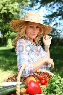 Woman with basket of vegetables.