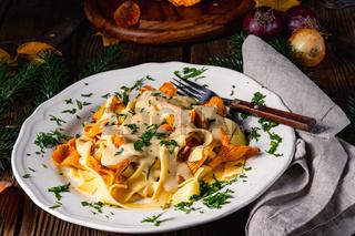 Tagliatelle with fresh chanterelles in a mushroom sauce