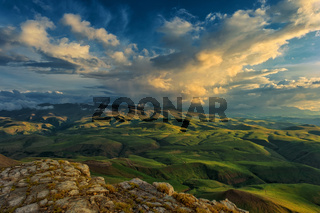 Sunset on hills in Caucasus mountains