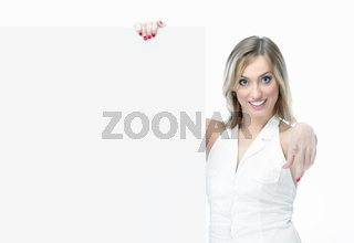 Smiling woman holding a blank billboard
