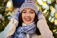 portrait of happy young woman in christmas lights