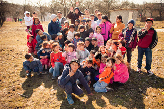 SEREDNIE, UKRAINE - MARCH 09, 2011: Citizens of remote areas are happy to meet new people
