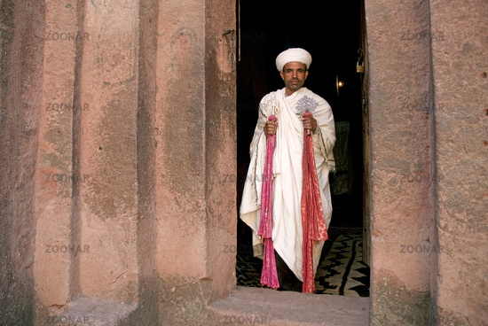 priest at ancient rock hewn churches of lalibela ethiopia