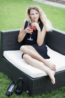 Alluring woman with a glass in her hands