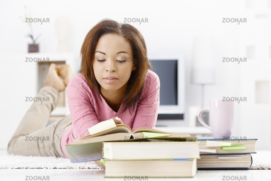 University girl studying at home