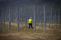 Worker solar panels installation