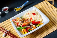 fried sweet and sour chicken with vegetables