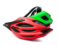 Red and green bicycle helmet upside-down isolated on white