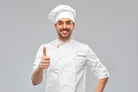 smiling male chef in toque showing thumbs up