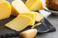 Block of hard cheese. Sliced cheese.
