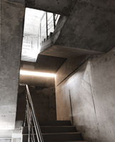 Empty cement concrete staircase with steel handrails inside of building under construction