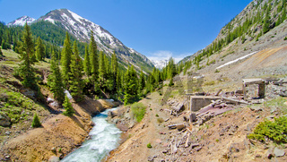 A Mountain Stream and an old silver mine in Animas Forks, a Ghost Town in the San Juan Mountains of Colorado