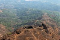 Edge of the fort with water bodies from the Suvela Machi top, Rajgad fort, Pune, Maharashtra, India.