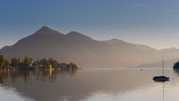 The village Walchensee on the alpine mountain lake Walchensee with mountains in background in early morning dawn