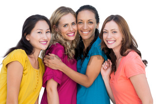 Cheerful models posing hugging each other