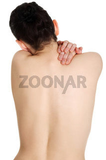 Young woman with pain in her back