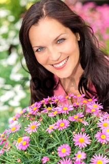 Portrait beautiful woman with purple daisy flowers