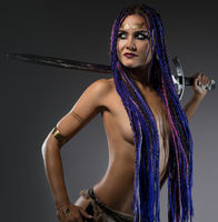Sexy confident woman with sword in studio