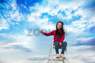 the girl on top of ladder that goes to the sky