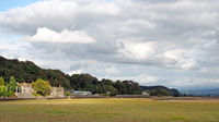 view of grange over sands in cumbria with the railway station and town buildings