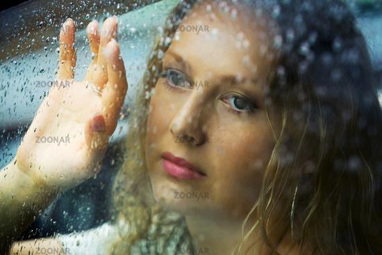 Sad woman and a rain