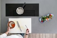 Top view of chef cooking in modern kitchen.