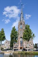 View at Sint-Laurentius church near canal downtown Dutch city Weesp