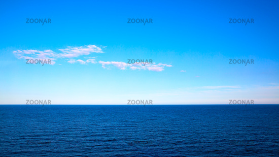Panoramic seascape with sea horizon and blue sky