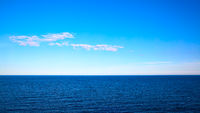 Panoramic seascape with sea horizon and blue sky
