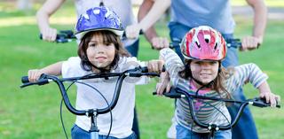 Jolly children riding a bike
