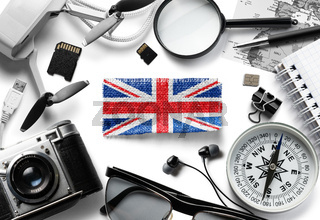 Flag of United Kingdom and travel accessories on a white background.