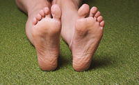 soles of feet of barefoot female person