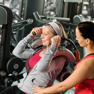 Senior woman exercise with personal trainer
