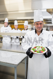 Head chef showing a salad