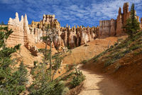 Tourists hiking among the hoodoos in the Queens Garden Trail. Bryce Canyon National Park. Utah USA