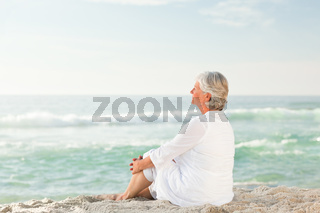 Woman who is sitting on the beach